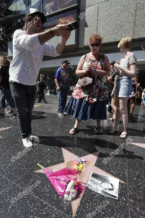 Pablo Fusco from Argentina takes a picture of US actor Jerry Lewis' star on the Hollywood Walk of Fame in Hollywood, California, USA, 20 August 2017.  US Entertainer and comedy legend Jerry Lewis has died at his home in Las Vegas, Nevada on 20 August 2017. He was 91. Lewis was best known for his work with Dean Martin and for raising money for muscular dystrophy research.