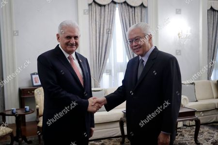 Stock Photo of Turkey's Prime Minister Binali Yildirim, left, shakes hands with Singapore's President Tony Tan at the Istana or presidential palace on in Singapore