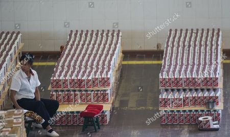Workers pack battles of baijiu in Kweichow Moutai Company in Maotai town, Guizhou province, China, 19 August 2017. (issued 21 August) Moutai is a brand of baijiu, a distilled Chinese liquor (spirit), made in the town of Maotai in China's Guizhou province. Produced by the state-owned Kweichow Moutai Company, the beverage is distilled from fermented sorghum and now comes in several different varieties.