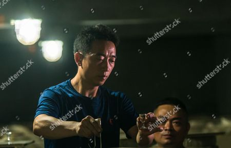 Li Mingcai owner of company pours baijiu from container in Qianyuan Alcohol Corporation LTD in Maotai, Guizhou province, China, 19 August 2017. (issued 21 August) Moutai is a brand of baijiu, a distilled Chinese liquor (spirit), made in the town of Maotai in China's Guizhou province. Produced by the state-owned Kweichow Moutai Company, the beverage is distilled from fermented sorghum and now comes in several different varieties.