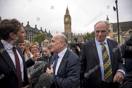MPs Stephen Pound and Peter Bone talking to media on Parliament Square after Big Ben chimed for the last time ahead of repair works