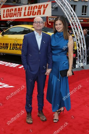 Steven Soderbergh, Jules Asner Director Steven Soderbergh, left, and his wife Jules Asner pose for photographers upon arrival at the premiere of the film 'Logan Lucky' in London