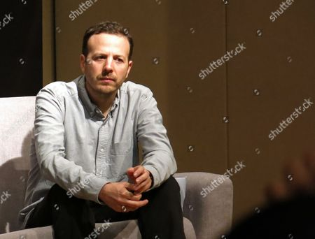 Stock Image of Mexican director Amat Escalante takes part in a press conference regarding the upcoming 4th edition of the Fenix Awards in Mexico City, . The awards ceremony will be held on Dec. 6, 2017 in Mexico City