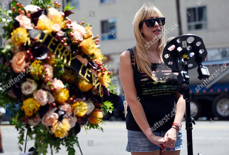 Kimi Lewis, granddaughter of the late comedy icon Jerry Lewis, speaks to the media during a memorial wreath ceremony for Lewis at his star on the Hollywood Walk of Fame, in Los Angeles. Lewis died at 91 on Sunday in Las Vegas, NV