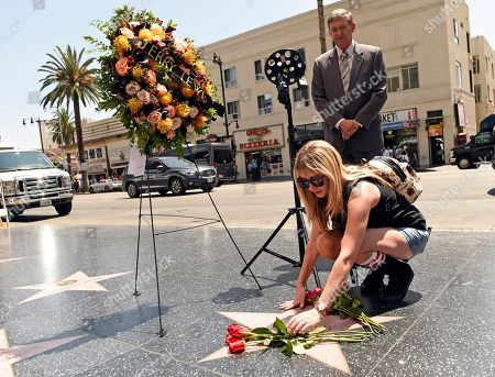 KImi Lewis, Leron Gubler Kimi Lewis, granddaughter of the late comic icon Jerry Lewis, places flowers on his star on the Hollywood Walk of Fame as Hollywood Chamber of Commerce Chairman and CEO Leron Gubler looks on during a memorial wreath ceremony, in Los Angeles. Lewis died at 91 on Sunday in Las Vegas, NV