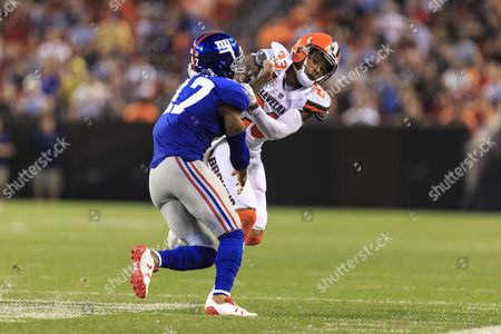 Stock Picture of New York Giants defensive back Valentino Blake (47) running down field during punt in the NFL football game between the New York Giants and the Cleveland Browns at First Energy Stadium in Cleveland, Ohio