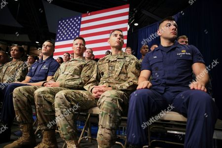 Members of the U.S. Military listen as President Donald Trump speaks at Fort Myer in Arlington Va., during a Presidential Address to the Nation about a strategy he believes will best position the U.S. to eventually declare victory in Afghanistan