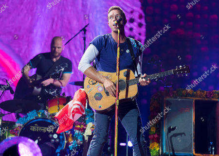 Will Champion, Chris Martin Will Champion and Chris Martin of Coldplay perform onstage at the Rogers Centre on in Toronto, Canada