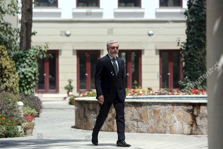 """Afghanistan's Chief of Executive, Dr. Abdullah Abdullah, arrives for press conference in Kabul, Afghanistan, . Reversing his past calls for a speedy exit, Trump recommitted the United States to the 16-year-old war in Afghanistan Monday night, declaring U.S. troops must """"fight to win"""
