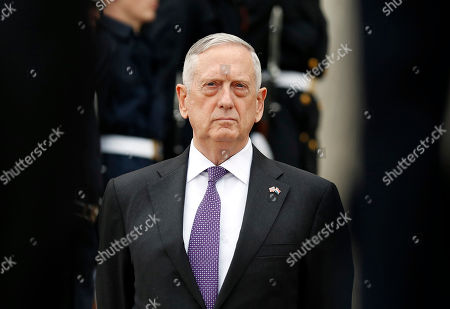 U.S. Defense Secretary Jim Mattis stands as he waits for Netherlands Minister of Defense Jeanine Hennis-Plasschaert during an enhanced honor cordon at the Pentagon in Washington. U.S. As Mattis arrived in Baghdad Tuesday, he said says Islamic State militants are caught in a military vise that will squeeze them from both ends of the Euphrates River valley that bisects Iraq and Syria