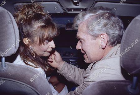 Sue Elliott (as Julie Dewhurst) and Geoff Hinsliff (as Don Brennan)