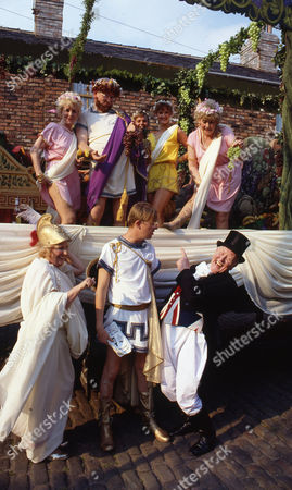 Front row l to r: Paula Tilbrook (as Vivian Barford), Kevin Kennedy (as Curly Watts) and Bill Waddington (as Parcy Sugden) Back row l to r: Lynne Perrie (as Ivy Brennan), Ken Morley (as Reg Holdsworth) and Elizabeth Dawn (as Vera Duckworth)