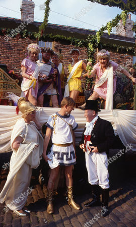 Front row l to r: Paula Tilbrook (as Vivian Barford), Kevin Webster (as Curly Watts) and Bill Waddington (as Parcy Sugden) Back row l to r: Lynne Perrie (as Ivy Brennan), Ken Morley (as Reg Holdsworth) and Elizabeth Dawn (as Vera Duckworth)