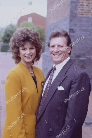 Shirin Taylor (as Jackie Ingram) and Johnny Briggs (as Mike Baldwin)