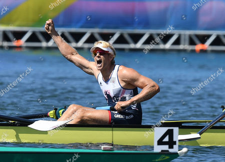 Andrew Triggs Hodge Salutes Gold Medal Win. Team Gb Rowing Mens Eight Scott Durrent Tom Ransley Andrew T Hodge Matt Gotrel Pete Reed Paul Bennett Matt Langridge William Satch Phelan Hill. Rio Olympics Brazil.