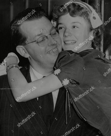 Actress Kathryn Beaumont Is Greeted By Her Father Ken Beaumont At Waterloo Station. Box 711 825101632 A.jpg.