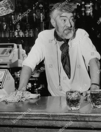 Stock Picture of Actor Ivan Beavis Who Once Played Harry Hewitt In Coronation Street Pictured Helping Out Behind The Bar Of The Harrow Pub Just Off Fleet Street While He Is Between Acting Jobs. Box 712 327101635 A.jpg.