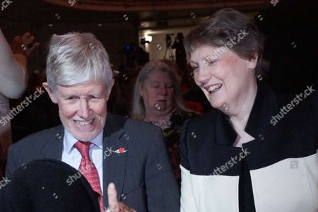 Former Prime Minister Helen Clark (R) with her husband Peter Davis (L) attend the Labour Party's official campaign launch at Auckland Town Hall.