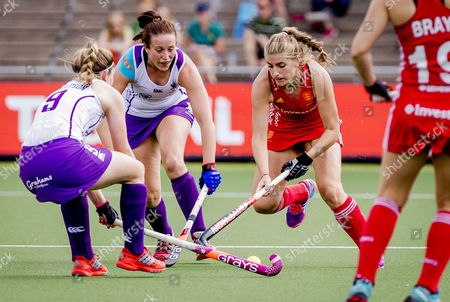 Sarah Haycroft (2-R) of England duels with Katie Robertson (L) of Scotland during the  women's Hockey Rabo EuroHockey Championships 2017 match between England and Scotland in Amstelveen, The Netherlands, 22 August 2017.