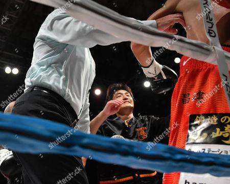 (L-R)  Shin Yamato, Shinsuke Yamanaka (JPN) - Boxing : Shinsuke Yamanaka of Japan is held by trainer Shin Yamato after being defeated with a fourth-round TKO in the WBC bantamweight title bout at Shimazu Arena Kyoto in Kyoto, Japan.