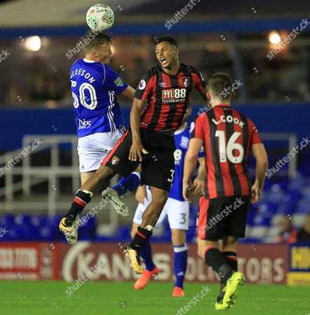 Stephen Gleeson of Birmingham City wins a header from Lys Mousset of Bournemouth