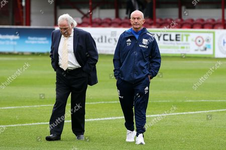 West Bromwich Albion manager Tony Pulis takes a walk on the pitch before kick off with Gerry Francis