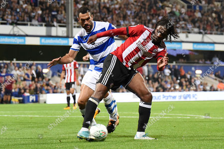 Romaine Sawyers of Brentford battles with Steven Caulker of Queens Park Rangers during the EFL Cup Match between Queens Park Rangers and Brentford at Loftus Road, Sheperd's Bush, London on August 22.