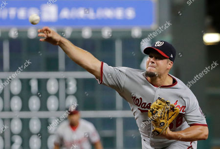 Stock Image of Washington Nationals relief pitcher Joe Blanton throws against the Houston Astros during the seventh inning of a baseball game, in Houston