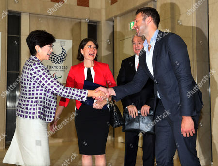 Tokyo Governor Yuriko Koike shakes hands with legendary Australian swimmer Ian Thorpe (R) while Australia's New South Wales Premier Gladys Berejiklian (2nd L) looks on at the Tokyo Metropolitan government office in Tokyo