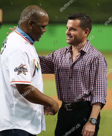 Tim Raines, David Samson Hall of Famer Tim Raines, left, is greeted by Miami Marlins president David Samson before the start of a baseball game between the Miami Marlins and the Colorado Rockies, in Miami. Raines was honored by the Marlins for being inducted into the Hall of Fame last month