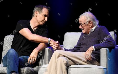 "Todd McFarlane, Stan Lee Comic book artist Todd McFarlane, left, greets comic book writer Stan Lee onstage at the ""Extraordinary: Stan Lee"" tribute event at the Saban Theatre, in Beverly Hills, Calif"