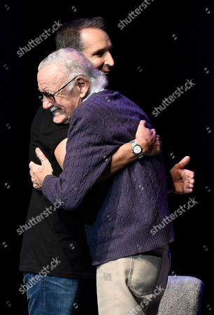 "Stan Lee, Todd McFarlane Comic book writer Stan Lee, facing left, embraces comic book artist Todd McFarlane onstage at the ""Extraordinary: Stan Lee"" tribute event at the Saban Theatre, in Beverly Hills, Calif"