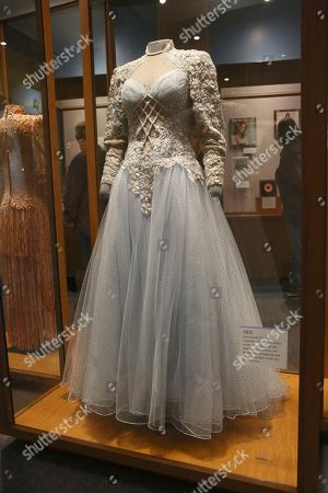 "The Tim Cobb gown worn by Loretta Lynn for the cover of her 2004 ""Van Lear Rose"" album. The gown is photographed inside the ""Loretta Lynn: Blue Country Girl"" exhibit at the Country Music Hall of Fame and Museum on in Nashville, Tenn"