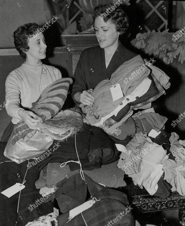 Actresses Sheila Bernette (left) And Eleanor Mccready Taking Gifts Of Warm Clothes To The Hungarian Refugees' Relief Centre At Notting Hill Gate Today. Box 714 501111620 A.jpg.