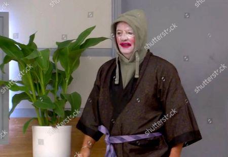 Derek Acorah dresses up as a clown