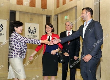 Tokyo Governor Yuriko Koike shakes hands with legendary Australian swimmer Ian Thorpe (R) while Australia's New South Wales Premier Gladys Berejiklian (2nd L) looks on at the Tokyo Metropolitan government office