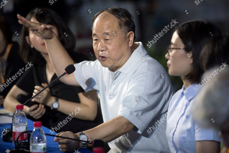 Chinese Literature Nobel Prize winner Mo Yan speaks during a panel discussion at the Beijing International Book Fair in Beijing, . The fair, which draws Chinese and international publishers, runs until Aug. 27