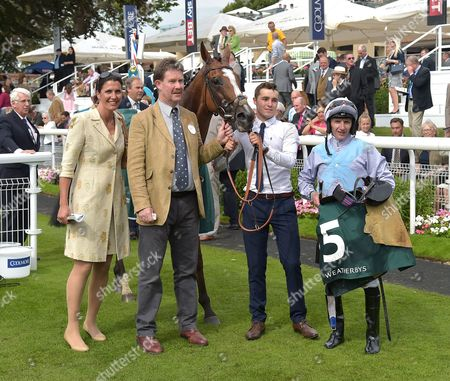 Connections of Montaly after winning The Weatherbys Hamilton Lonsdale Cup, inc (L) Anna-Lisa Balding, the trainers wife and (R) jockey, P.J.McDonald.