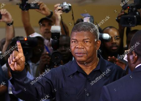 Angola's MPLA main ruling party candidate and defence minister, Joao Lourenco, shows his ink-stained finger after casting his vote in Luanda, Angola, . Lourenco is the front-runner to succeed President Jose Eduardo dos Santos, who will step down after 38-years in power in an oil-rich country
