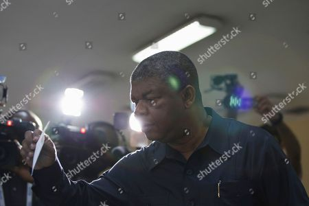 Angola's MPLA main ruling party candidate and defence minister, Joao Lourenco, casts his ballot in Luanda, Angola, . Lourenco is the front-runner to succeed President Jose Eduardo dos Santos, who will step down after 38-years in power in an oil-rich country
