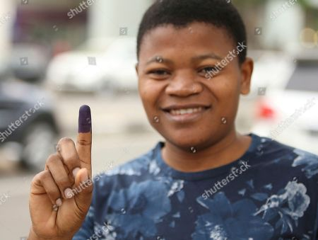 A voter shows his ink-stained finger at a polling station in Luanda, . Angola's MPLA main ruling party candidate and defence minister, Joao Lourenco is the front-runner to succeed President Jose Eduardo dos Santos, who will step down after 38-years in power in an oil-rich country