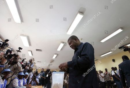 Angola's MPLA main ruling party candidate and defence minister, Joao Lourenco, casts his vote in elections in Luanda, . Lourenco is the front-runner to succeed President Jose Eduardo dos Santos, who will step down after 38 years in power in an oil-rich country