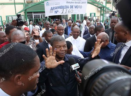 Angola's MPLA main ruling party candidate and defence minister, Joao Lourenco, shows his ink-stained finger as he faces the media after casting his vote in elections in Luanda, Angola, . Lourenco is the front-runner to succeed President Jose Eduardo dos Santos, who will step down after 38 years in power in an oil-rich country