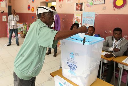 A voter casts his vote in elections in Luanda, Angola, . Defense Minister, Joao Lourenco, is the front-runner to succeed President Jose Eduardo dos Santos, who will step down after 38 years in power in an oil-rich country