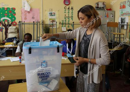 A voter casts her vote in elections in Luanda, Angola, . Defense Minister, Joao Lourenco, is the front-runner to succeed President Jose Eduardo dos Santos, who will step down after 38 years in power in an oil-rich country