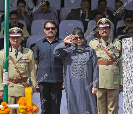 Jammu and Kashmir Chief Minister Mehbooba Mufti salutes on the occasion of 71st Independence Day Celebrations. Mufti welcomed Prime Minister Narendra Modi's remarks that separatism in Jammu and Kashmir will be defeated by embracing Kashmiris and not by violence.