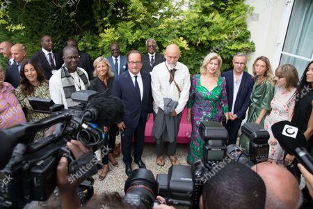 Francois Hollande, First Lady Dominique Folloroux-Ouattara, President of Jury John Malkovich
