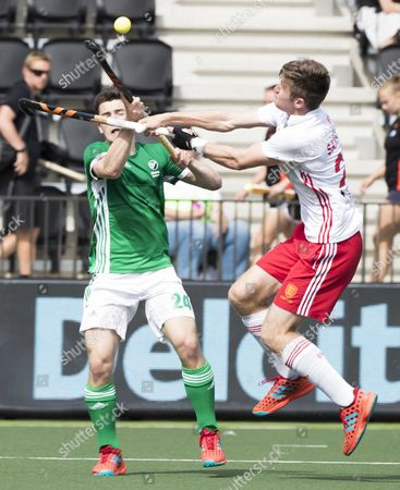 Ireland's Ben Walker (L) and Liam Sanford of England in action during the EuroHockey Championships 2017 match between Ireland and England in Amstelveen, The Netherlands, 23 August 2017.