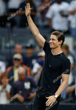 Derek Klena star of Anastasia on Broadway, sings the national anthem before a baseball game between the New York Mets and the New York Yankees, at Yankee Stadium in New York. The Yankees defeated the Mets4-2