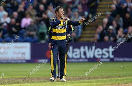 Stock Picture of Colin Ingram of Glamorgan celebrates bowling and catching Tom Wells of Leicestershire.